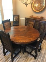 Spanish Iron & Wood Formal Dining Table and 6 Cow Hide Chairs in The Woodlands, Texas