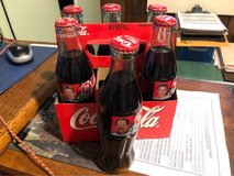 Unopened mint condition Coke Classic Dale Earnhardt and other race drivers on bottles in Fort Polk, Louisiana