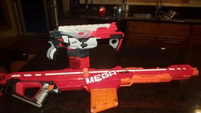 nerf guns, the nerf mega blaster and the nerf pyragon nerf guns with some bullets in Chicago, Illinois