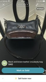Black and brown leather cross body bag in Fort Lee, Virginia