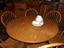 Round Oak Table with Two Leaves and Six Chairs in Fort Riley, Kansas
