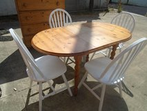 Pine dining table and chairs in Lakenheath, UK