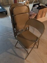 Tan metal folding chairs in Naperville, Illinois