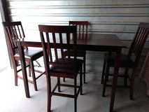 Height top solid wood table with 4 comfortable chairs in Fort Bliss, Texas