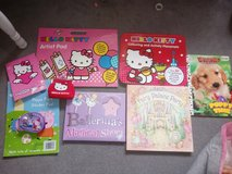 girls colouring books a few story books and 2 purses in Lakenheath, UK