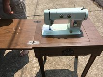 Sewing machine and cabinet in Fort Campbell, Kentucky