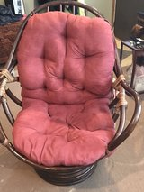 wicker chair with cushion in Rolla, Missouri