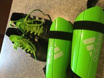 Kids size 2 Adidas cleats and shin guards in Plainfield, Illinois