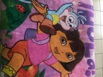 Dora blanket and two huge dolls in Fort Bliss, Texas
