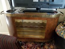 Vintage mid century modern wood & brass oval portable bar with glass rack in Chicago, Illinois