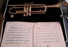 Trumpet with brass mouth piece, case and some sheet music in Shorewood, Illinois
