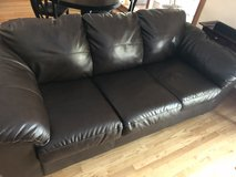 Brown leather couch in Shorewood, Illinois