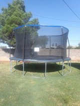 14ft Trampoline with net enclosure in Alamogordo, New Mexico