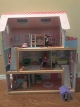 Doll house with wooden dolls and furniture in Fort Leonard Wood, Missouri