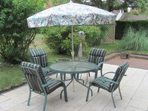 Patio set - Table with umbrella, 4 chairs with cushions, and small table in Ramstein, Germany