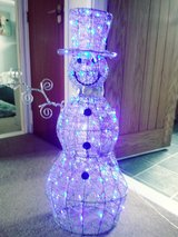 snowman light up one arm missing in Lakenheath, UK