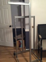 Commercial clothing rack, on wheels, 4 adjustable arms in Quantico, Virginia