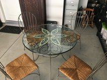 Cute glass dining table with chairs in Oceanside, California