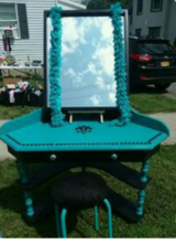 Black and turquoise vanity in Fort Drum, New York