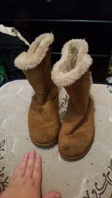 Fuzzy tan boots in Clarksville, Tennessee
