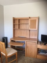 Desk and bookshelf in Fort Carson, Colorado