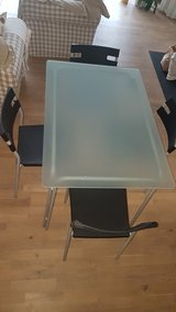 Glass table with 4 chairs in Ramstein, Germany