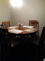 (Negotiable) Extended Dinning Table (Round) with 4 high chairs in Hinesville, Georgia