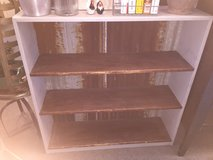 Repurposed bookcase with old metal backing in Bartlett, Illinois