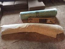 New carpet, box of tack strips, and roll of padding in Fort Campbell, Kentucky