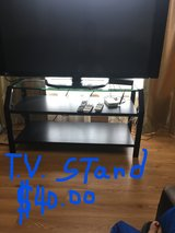 TV STAND GLASS SURROUNDED BY METAL in Camp Humphreys, South Korea