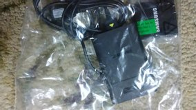 Samsung battery charger comes with 2 battery's in Fort Leonard Wood, Missouri
