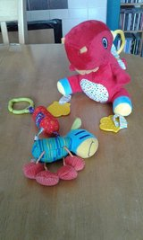 Nuby dinosaur and zebra stroller toys in Lakenheath, UK