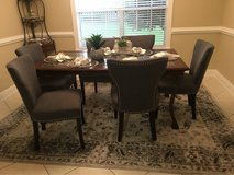 6 Dark grey nail studded linen chairs, wood, glass and wrought iron table and rug. in Moody AFB, Georgia