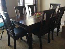 Solid wood dining room table w/ 6 leather seated chairs in Liberty, Texas