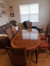 Dinning Room Table Expandable with Leaf and Cover and six matching chairs. in Fort Meade, Maryland