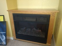 Heat Surge electric heater with real wood oak cabinet in Alamogordo, New Mexico