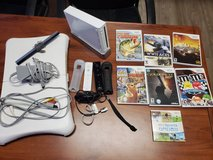 Wii console with games and controllers in Bellaire, Texas