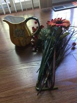 Bunch of fall fake flowers and fall decorative pitcher in Naperville, Illinois