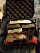 4 mags to Glock 40 and set of grips and one extended mag and s&w 9 mag case and lock in Fort Riley, Kansas