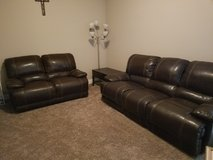 Recliner leather couch and coffee table in Fort Leonard Wood, Missouri