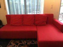 Red ikea sleeper couch with storage in Stuttgart, GE