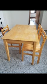 Wood dining table and 3 chairs in Ramstein, Germany