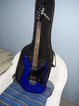 Electric guitar and amp in Joliet, Illinois