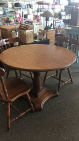 Table with three chairs in Fort Leonard Wood, Missouri