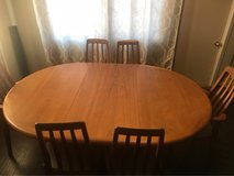 wood dinning room table w/extension and cover and (6)chairs in 29 Palms, California
