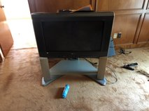 Tv w/ stand in Kingwood, Texas