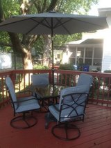 Outdoor table/4 rocker chairs/umbrella with stand and chair pads in St. Charles, Illinois
