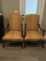 Set of upholstered, wood arm chairs in Pensacola, Florida