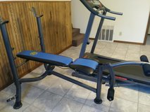 Workout bench with bar and plates. in Fort Leonard Wood, Missouri
