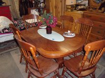 Oak Oval Table Has Ball/Claw Feet With Six Matching Chairs Set in Fort Riley, Kansas